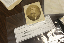 Scott Sommerdorf  |  The Salt Lake Tribune From Brent Ashworth's collection of Hofmann memorabilia, a faked inscription on a photo of abolitionist John Brown and a Hofmann cashier's check made out in the sum of $142,270.