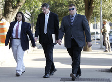 Tony Gutierrez  |  The Asociated Press  Law enforcement officers escort polygamous-sect leader Warren Jeffs, center, into the Tom Green County Courthouse Wednesday in San Angelo, Texas.