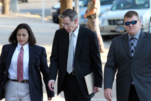 Patrick Dove  |  San Angelo Standard-Times Law enforcement officers escort polygamous-sect leader Warren Jeffs, center, into the Tom Green County Courthouse on Wednesday in San Angelo, Texas.
