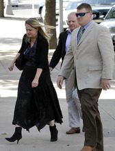 Carolyn Jessop, left, a former Fundamentalist Church of Jesus Christ of Latter Day Saints member arrives escorted by law enforcement officers at Tom Green County Courthouse for the sentencing phase of Warren Jeffs' sexual assault trial Thursday Aug. 4, 2011, in San Angelo, Texas. A Texas jury convicted polygamist sect leader Warren Jeffs of child sexual assault on Thursday, in a case stemming from two young followers he took as brides in what his church calls