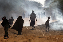 Somali refugees walk through the  eastern Kenyan village of Hagadera near Dadaab, 100 kms (60 miles) from the Somali border, Friday Aug. 5, 2011. The drought and famine in the horn of Africa has  killed more than 29,000 children under the age of 5 in the last 90 days in southern Somalia alone, according to U.S. estimates. The U.N. says 640,000 Somali children are acutely malnourished, suggesting the death toll of small children will rise. (AP Photo/Jerome Delay)