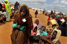 Dahabo Osman,  60  from Somalia, queues for soap and an oil container after registering at UNHCR's Ifo Extention camp set outside  Dadaab, eastern Kenya, 100 kms (60 miles) from the Somali border, Friday Aug. 5, 2011.  The camp, registering over 1,000 newcomers a day, has been set to provide better accommodation, sanitary conditions and security for Somali refugees. The drought and famine in the horn of Africa has  killed more than 29,000 children under the age of 5 in the last 90 days in southern Somalia alone, according to U.S. estimates. The U.N. says 640,000 Somali children are acutely malnourished, suggesting the death toll of small children will rise. (AP Photo/Jerome Delay)