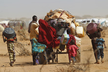 A Somali family relocates to UNHCR's Ifo Extention camp set outside Dadaab, eastern Kenya, 100 kms (60 miles) from the Somali border, Friday Aug. 5, 2011.  The camp, registering over 1,000 newcomers a day, has been set to provide better accommodation, sanitary conditions and security for Somali refugees. The drought and famine in the horn of Africa has  killed more than 29,000 children under the age of 5 in the last 90 days in southern Somalia alone, according to U.S. estimates. The U.N. says 640,000 Somali children are acutely malnourished, suggesting the death toll of small children will rise. (AP Photo/Jerome Delay)