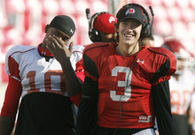 Scott Sommerdorf  |  The Salt Lake Tribune Utah QB Jordan Wynn jokes with WR Devonte Christopher during Spring practice. The Utes scrimmaged Friday night, April 1st, 2011 at Rice Eccles Stadium.
