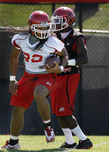 Scott Sommerdorf  |  The Salt Lake Tribune Utah RB Thretton Palamo (22) turns to run after catching a pass during practice on the Utah baseball field at the University of Utah Thursday, August 4, 2011.