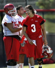 Scott Sommerdorf  |  The Salt Lake Tribune Utah QB Jordan Wynn talks with OL Tevita Stevens during a break in practice on the Utah baseball field at the University of Utah Thursday, August 4, 2011.
