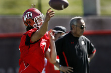 Scott Sommerdorf  |  The Salt Lake Tribune Utah QB jordan Wynn throws under the watchful eye of Offensive Coordinator Norm Chow during practice on the Utah baseball field at the University of Utah Thursday, August 4, 2011.