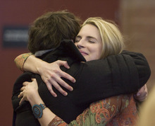 Steve Griffin     The Salt Lake Tribune Brit Marling gets a hug from a friend at the Sundance premiere of
