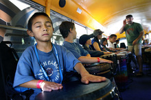 Scott Sommerdorf  |  The Salt Lake Tribune Six year old burn survivor Bobby Rolfe closes his eyes as facilitator Nels Anderson (right), asks the campers playing the