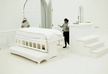 Forensic technicians exmaine a bed in the FLDS Church's temple at the Yearning for Zion Ranch in Texas. Prosecutors in Warren Jeffs' child sexual abuse trial have presented evidence that Jeffs had sex with underage girls in the temple.  Photo courtesy of Sam Brower