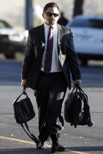 Defense attorney Deric Walpole, of McKinney, Texas, makes his way to the Tom Green County Courthouse, Monday, Aug. 8, 2011 in San Angelo, Texas for the 12th day of the sexual assault trial of Warren Jeffs.  Jurors convicted Jeffs last week of sexually assaulting two girls, ages 12 and 15, whom he'd taken as brides. He faces up to life in prison.  Jeffs has led the Fundamentalist Church of Jesus Christ of Latter Day Saints since 2002.  (AP Photo/ San Angelo Standard-Times, Patrick Dove)