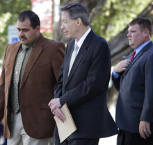 Law enforcement officials, left, and right, escort Warren Jeffs, center, out of the  Tom Green County Courthouse Friday Aug. 5, 2011, in San Angelo, Texas.  Jeffs, a polygamist sect leader convicted of child sexual assault walked out of his sentencing hearing in protest Friday, after reading a statement he claimed was from God. The statement promised a