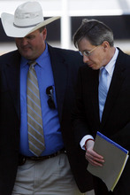 Convicted polygamist religious leader Warren Jeffs is escorted into the Tom Green County Courthouse, Tuesday, Aug. 9, 2011 by Sgt. Wesley Hensley of the Texas Attorney Generalís Office. Jeffs was sentenced to life in prison on Tuesday for sexually assaulting two underage followers he took as brides in what his church deemed