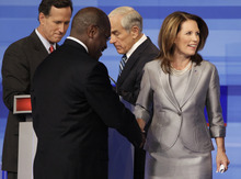 Republican presidential candidates Rep. Michele Bachmann, R-Minn., businessman Herman Cain, Rep. Ron Paul, R-Texas, and former Pennsylvania Sen. Rick Santorum are pictured at the end of the Iowa GOP/Fox News Debate at the CY Stephens Auditorium in Ames, Iowa, Thursday, Aug. 11, 2011. (AP Photo/Charlie Neibergall)