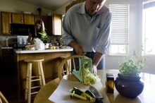 Djamila Grossman  |  The Salt Lake Tribune  Christopher and Megan Stubb make raw zucchini pasta with marinara sauce and coconut cream-filled chocolate patties, at their home in Riverton. Megan has been eating raw for about eight years, Christopher for about five.