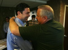 Steve Griffin  |  The Salt Lake Tribune Matt Moody, of Eagle Mountain, Utah, puts his arm around U.S. Rep. Jason Chaffetz as they talk prior to a town hall meeting at the Holiday Inn Express in American Fork on Wednesday, Aug. 10, 2011.
