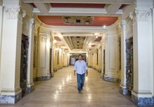 Paul Fraughton  |  Tribune file photo J.R. Howa, the son of Rick Howa, walks down the long entryway into the lobby of the Utah Theater on Salt Lake City's Main Street in July. The Salt Lake City Redevelopment Agency has agreed to buy the 1918-built playhouse for $5.5 million as part of a downtown cultural district. The theater could become a film center.