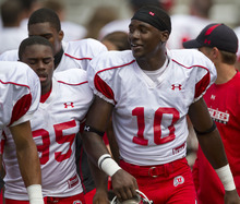Lennie Mahler  |  The Salt Lake Tribune DeVonte Christopher, right, and Charles Henderson joke as they leave the field after football practice Monday, Aug. 15, 2011, at Rice-Eccles Stadium.