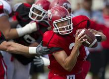 Lennie Mahler  |  The Salt Lake Tribune Utah quarterback Jordan Wynn tries to evade defenders during practice Monday, Aug. 15, 2011, at Rice-Eccles Stadium.
