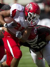 Lennie Mahler  |  The Salt Lake Tribune Utah's Kendrick Moeai runs for extra yards as Matt Martinez closes in during practice Monday, Aug. 15, 2011, at Rice-Eccles Stadium.