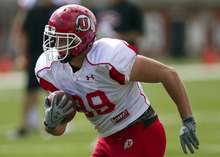 Lennie Mahler  |  The Salt Lake Tribune Dallin Rogers rushes with the ball during Utah football practice Monday, Aug. 15, 2011, at Rice-Eccles Stadium.