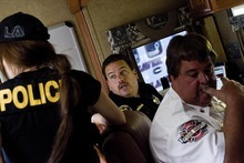 Djamila Grossman  |  The Salt Lake Tribune  Beaver County dispatch supervisor Paul Wolden and emergency services director Les Whitney listen as they run the command center as law enforcement officials move into an area to remove marijuana plants grown illegally in the Fishlake National Forest near Beaver, Utah, on Thursday, Aug. 18, 2011. Several agencies were involved in the operation.