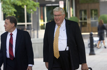 Al Hartmann  |  The Salt Lake Tribune  Dewey MacKay, right, a Brigham City doctor charged with illegally prescribing millions of pain pills, walks with his lawyer to Frank Moss Federal Courthouse last month for the opening of trial.