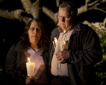 Mother and father of Susan Cox Powell Judy and Chuck Cox pray during a vigil for their daughter at an LDS chapel in Puyallup, Wash., on Saturday to remember her three months after her disappearance.  Stephen Brashear