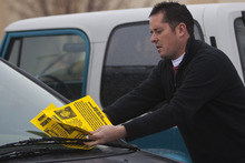 Photo by Chris Detrick  |  The Salt Lake Tribune  Paul Timpson hands out 'missing person' fliers on cars in a Smith's parking lot Saturday December 12, 2009. Susan Powell, 28, was seen last Sunday at her home and was reported missing by her relatives the next day.
