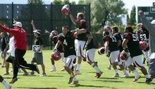Chris Detrick  |  The Salt Lake Tribune Members of the Utah defense cheer during practice at the University of Utah Thursday August 18, 2011.