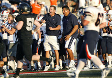 Scott Sommerdorf  |  The Salt Lake Tribune Timpview coaches including head coach Louis Wong react to a positive play from their offense during first half play. Alta defeated Timpview 35-14 in their first game of the high school football season, Friday, August 19, 2011.