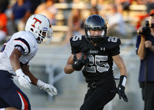 Scott Sommerdorf  |  The Salt Lake Tribune Alta RB Bryan Engstrom set up a TD with this first half reception. Alta defeated Timpview 35-14 in their first game of the high school football season, Friday, August 19, 2011.