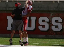 Leah Hogsten  |  The Salt Lake Tribune University of Utah football team's wide receiver Nick Brown is  congratulated by a staff member for a successful play.  The University of Utah football team scrimmages Saturday, August 20 2011 in Salt Lake City.