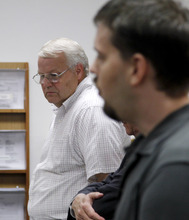 Chuck Cox, father of Susan Cox Powell, left, listens as Josh Powell speaks during a court hearing Tuesday, Aug. 23, 2011, in Tacoma, Wash. Josh Powell had alleged in a petition for a restraining order that his father-in-law Chuck Cox, of Puyallup, Wash., had threatened him and stalked him and his sons. Cox's lawyer said his client had never threatened Powell and had only tried to hug his grandchildren. Cox's lawyer also said his client had never maligned Powell or publicly suggested that Powell was responsible for Susan's disappearance. (AP Photo/Elaine Thompson)