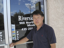 Lisa J. Church  |  Special for The Salt Lake Tribune  Moab motel owner Jung Park poses outside the Riverside Inn. Park confirmed that bones found off Interstate 70 this spring are likely those of his father, Hae C. Park, who is believed to have been murdered in 2010.