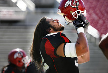 Scott Sommerdorf  |  The Salt Lake Tribune Utah LB Chaz Walker (32) puts on his helmet just before going in for some reps on defense as the Utes practice at Rice-Eccles stadium, Friday, August 12, 2011.