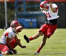 Scott Sommerdorf  |  The Salt Lake Tribune Utah K/P Coleman Petersen (61) attempts a FG during practice at the Utah baseball field, Monday, August 8, 2011.