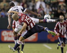 Chivas USA forward Alejandro Moreno(15) and Real Salt Lake defender Chris Schuler fight for the ball during the second half of an MLS soccer match at Home Depot Center in Carson, Calif., Saturday, Aug. 27, 2011. Real Salt Lake won 1-0. (AP Photo/Jae C. Hong)