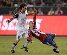 Chivas USA midfielder Laurent Courtois, right, is fouled by Real Salt Lake midfielder Kyle Beckerman during the second half of an MLS soccer match at Home Depot Center in Carson, Calif., Saturday, Aug. 27, 2011. Real Salt Lake won 1-0. (AP Photo/Jae C. Hong)