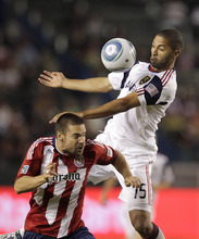 Real Salt Lake forward Alvaro Saborio, top, controls the ball with his chest as he is defended by Chivas USA defender Heath Pearce during the first half of an MLS soccer match at Home Depot Center in Carson, Calif., Saturday, Aug. 27, 2011. Real Salt Lake won 1-0. (AP Photo/Jae C. Hong)