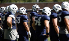 Francisco Kjolseth  |  The Salt Lake Tribune The offensive line listens to instructions for another drill as BYU holds a practice with many fans in attendance on Tuesday, Aug. 16, 2011.