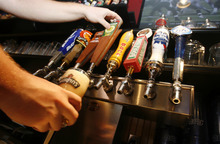 Francisco Kjolseth  |  The Salt Lake Tribune Beer taps may soon need to also be obscured from the public as Carlos Walter, a supervisor at Wing Nutz in Sugarhouse, pours a customer a beer on Monday, Aug. 29, 2011.