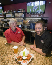 Al Hartmann  |  The Salt Lake Tribune Will Miller, left, and Will Owens are partners with Wing Nutz, a Utah-based restaurant chain with a dozen locations.   This one is in Sugarhouse.  It's a casual place where familes come to socialize, eat some chicken wings with their beer or soda and watch sports on big screen tv's.    The beer taps and bar behind them will either disappear soon or not be used due to new regulations.  Beer will have to be poured out of sight in a side room, behind a