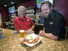 Al Hartmann  |  The Salt Lake Tribune Will Miller, left, and Will Owens are partners with Wing Nutz, a Utah-based restaurant chain with a dozen locations.   This one is in Sugarhouse.