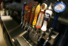 Francisco Kjolseth  |  The Salt Lake Tribune Beer taps may soon need to also be obscured from the public as beer taps sit in plain view at Wing Nutz in Sugarhouse on Monday, Aug. 29, 2011.