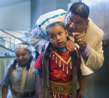 Al Hartmann  |  The Salt Lake Tribune Jason Walker, chairman of the Northwestern band of Shoshone, gives his daughter Carlise, 6, some encouragment before going out to dance in front of the annual Native American Summit in Salt Lake City on Tuesday.