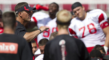 Lennie Mahler  |  The Salt Lake Tribune Utah head coach Kyle Whittingham speaks to the team at the close of football practice Monday, Aug. 13, 2011, at Rice-Eccles Stadium.