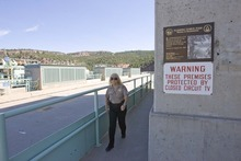 Paul Fraughton  |  The Salt Lake Tribune Sgt. Cher Maras makes her security rounds at the dam on Thursday, Aug. 18, 2011.