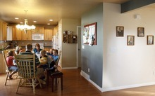 Trent Nelson     The Salt Lake Tribune The Burton family gathers for dinner Thursday, Aug. 25, 2011. The Burton family is trying to sell their home in Tooele due to a job transfer. Despite adding more than $20,000 in improvements since they purchased their home in 2005, they are now asking only what they paid for the home. Left to right are Kaitlyn, Emily, Scott, Angela, Zachary, Spencer and Jeffrey Burton.