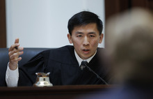 New California Supreme Court Justice Goodwin Liu speaks to attorney Theodore Olson, partly shown at right, in a courtroom during a California State Supreme Court hearing in San Francisco, Tuesday, Sept. 6, 2011. On Tuesday, the California Supreme Court will be considering whether the sponsors of Proposition 8 have a legal right to appeal the federal court ruling that overturned the same-sex marriage ban, since the governor and attorney general refused to bring such an appeal. The 9th US District Court of Appeals, which has main responsibility for the case on appeal, asked the state court to weigh in on the question it deals with the state's ballot initiative process. (AP Photo/Paul Sakuma)